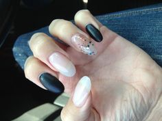 Black and sparkly oval nails I love them!! Hope they last on vacation