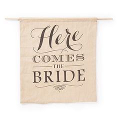 Your ring bearer and flower girl will announce your arrival in rustic style with this banner. The natural linen banner has a 'Here Comes The Bride' design in black.