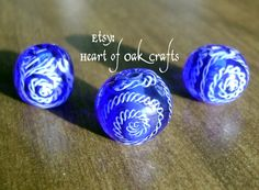 Glowingly blue, this Celtic bead with spiral designs in fine blue/white twisty stringer sparkles in the sunlight. By Heart of Oak Crafts on Etsy. Irish Clothing, Clay Beads, British Museum, Bead Art, Beading Patterns, Spiral, Celtic, Etsy Seller, Blue And White