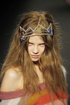 this little devil found herself a crown.....