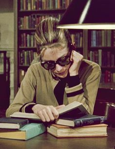"Audrey Hepburn in 1961's ""Breakfast At Tiffany's"". Holly researching rich bachelors at the main branch of the New York Public Library."