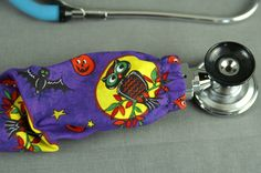 Celebrate Halloween with this Spooky OWL stethoscope cover. Dress up your scrubs and attire with this fashionable accessory. Measuring x this cover will fit any stethoscope and can be slid on Dollhouse Accessories, Doll Accessories, Stethoscope Accessories, Stethoscope Cover, Halloween Owl, Owl Fabric, Doctor Gifts, Cord Cover, Doll Beds