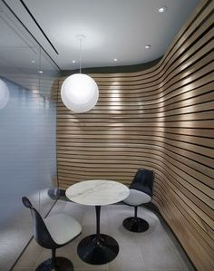 A small nook--that is just part of the feature walls in a New York law firm.  The undulating wooden walls were made from white oak planks--which together total over 3 miles in length.