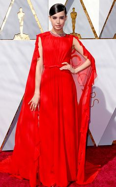 Sofia Carson from Standout Style Moments From Oscars 2018  The Disney star arrived to the Oscars in a red cape dress with ruffle trim.