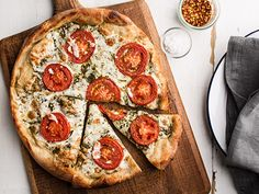 Pizza with Pesto, Fresh Tomatoes, and Mozzarella Recipe | Epicurious.com