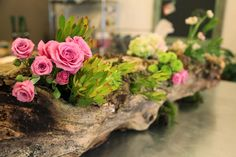 Every time I drive or walk by Laura Iarocci's fantastic shop, Faith Flowers, I feel inspired. She always has the mostthoughtful and creativefloral creations- like her salvaged log centerpieces filled with fresh and vibrant flowers. I instantly wanted to blog about this latest creation. Luckily, sh