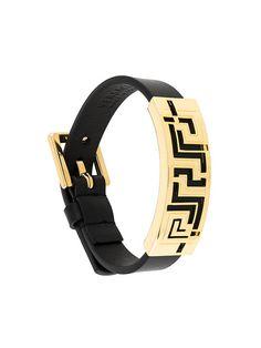 Shop Versace Greca Key bracelet.