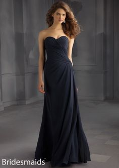 A surplice bodice tops the modified A-line silhouette of Mori Lee 705 Bridesmaid Dress, defined by richly ruched panels that leave a strapless sweetheart neckline as they settle into the asymmetrical drop waist.