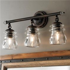 Something like this above sink in mudroom?  Insulator Glass 3-Light Bath Light Rustic Bathroom Lighting, Rustic Bathroom Vanities, Bathroom Light Fixtures, Bathroom Vanity Lighting, Rustic Bathrooms, Vanity Mirrors, Lighting Ideas, Track Lighting, Bathroom Lamps