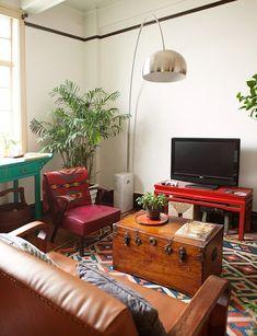 Mark's Shanghai style tiny boho apartment. Gorgeous chest and kilim rug!