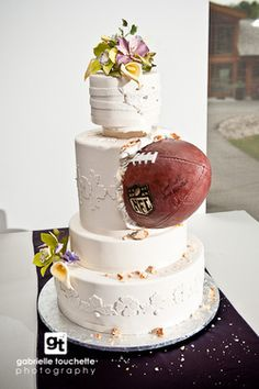 """Elegant themed """"NFL football"""" wedding cake by cakestudio.ca...Love it! My take would be to change the flowers to orange and the football to be an NCAA Tennessee football :)"""