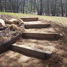 DIY Garden steps in a hillside using timbers. Flower bed on one side, lawn on the other. The steps hug the curve of the flower bed. First spring project, done! Garden Yard Ideas, Diy Garden, Landscape Timbers, Backyard Landscaping, Landscape Stairs, Hillside Landscaping, Garden Stairs, Landscaping A Slope, Garden Steps Diy
