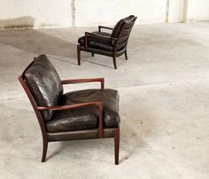 Pair of 2 Arne Norell Lounge Chairs in Black Leather | From a unique collection of antique and modern lounge chairs at http://www.1stdibs.com/furniture/seating/lounge-chairs/