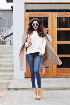 love the pop of color in her sunglasses .//. This outfit is EVERYTHING .//. camel, skinny jeans, cape, pumps, denim, YES