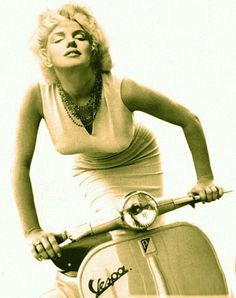 Marilyn posing on a vespa