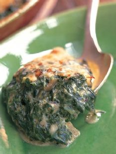 Barefoot Contessa Spinach Gratin (use 2 cups low fat milk) and I think halving the butter would work fine.