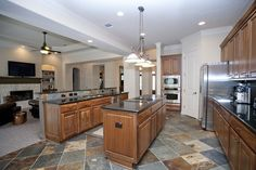 slate floor, black countertops. I think I would want more consistency in teh floor to avoid business.    Google Image Result for http://activerain.com/image_store/uploads/3/0/3/5/9/ar130945837295303.jpg