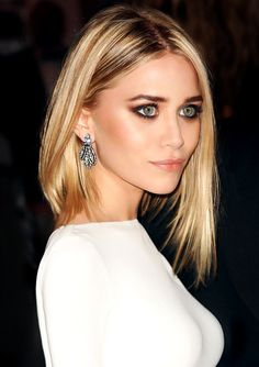 bold makeup and hair with an Olsen Twin