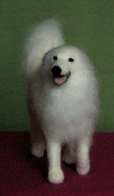 Needle felted Great Pyrenees soft sculptures.