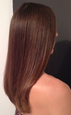 Beautiful, thick, long layered, wavy hair styled straight... kL Groove Elliptic Hairbrush...