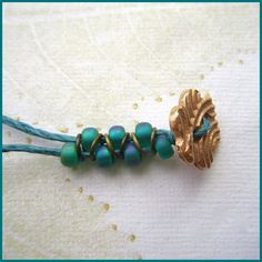 The Gossiping Goddess: Tutorials - this simple piece uses cord, button clasp, and wire rings in between the beads.  #beading #tutorial
