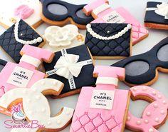 Assorted Chanle No.5 cokie in pink and black cookies - SmartieBox Cake Studio