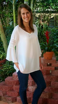 This adorable ivory tunic top can go anywhereI The tunic top features pretty lace detail and bell shaped 3/4 length sleeves. Wear with skinny jeans, jeggings, shorts,or your favorite leggings for a co