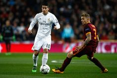 James Rodriguez of Real Madrid is closed down by Lucas Digne of Roma during the UEFA Champions League Round of 16 Second Leg match between Real Madrid and Roma at Estadio Santiago Bernabeu on March 8, 2016 in Madrid, Spain. (March 7, 2016 - Source: Gonzalo Arroyo Moreno/Getty Images Europe)