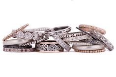 A collection of white and brown brilliant-cut diamond stackable rings in silver and rose gold by GALACIA DESIGNER JEWELLERY.