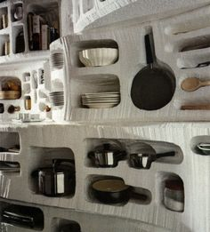 I wouldn't want a hidey-hole for all of our kitchen accoutrements, but I love this idea for plates and bowls!