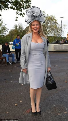 Gorgeous: Carol Vorderman made sure she displayed her incredible figure in a grey dress as she attended the QIPCO British Champions Day race meeting at Ascot Racecourse