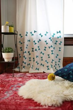Use a potato stamp to add a sweet bowtie pattern to a simple curtain panel