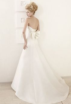 Strapless long white wedding dress with back bow resembling fairy wings from Atelier Aimee.