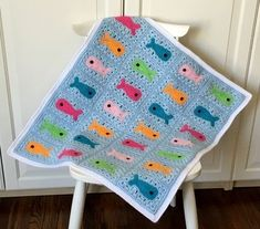 """Crochet+pattern+for+a+colorful+and+FULLY+REVERSIBLE+""""fishy""""+baby+blanket+/+young+child's+blanket.  This+KnotYourselfOut+crochet+blanket+is+named:+FISHY+LITTLE+BABY+BLANKET.  I+know+I+say+it+often,+and+here+I+go+again:+I+really+LOVE+this+cute+and+colorful+baby+blanket.+I+think+the+little+fish+are+adorable,+and+I+had+so+much+fun+designing+them!  With+this+pattern,+I+have+managed+to+incorporate+the+fish+right+""""into""""+the+background+(versus+sewing+it+on+top+of+the+background,+which+is+what+..."""