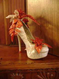Krewe of Muses shoes are thrown into the crowd during Mardi Gras, New Orleans Glitter Jacket, Glitter Shoes, Muses Shoes, Fall Swags, Indoor Wedding Ceremonies, Flower Shoes, Flower Art, Mardi Gras Costumes, Jeweled Shoes