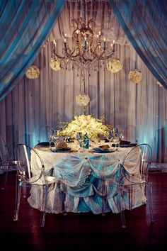 use draping on the walls with flowers and paper fans or balls interspersed