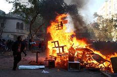 A demonstrator watches a burning barricade during a protest in Santiago, Chile, 12 November Mexican News, House Of Commons, 12 November, Picture Editor, Environmental Issues, Baja California, Best Photographers, Mexico City, Central America