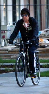 Bob Dylan rides his bike.