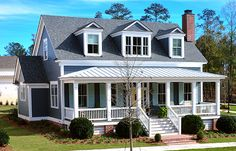 This efficient raised cottage with Colonial-Revival elements has great curb appeal and embodies many of the favorite elements of classic Southern Architecture. The generous five-bay front porch conjures up evenings sitting in rocking chairs and visiting with neighbors. The three, gabled front dormers are carefully proportioned and functional as well as decorative. In addition to having a slightly less formal feel, the two over two double hung windows that are used throughout the house offer…