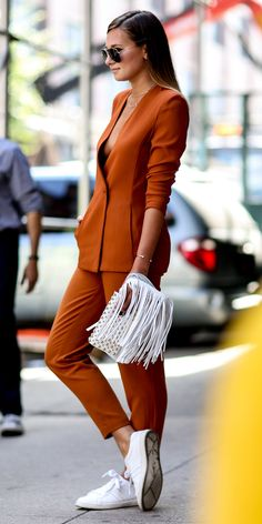 #NYFW Spring 2015 Street Style | Orange Suite with White Fringe Bag Via IMAXTREE