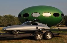 Futuro House and Shark Fiberglass Sports Car - It's 2014 and I want to know where my spaceship house and flying car are.