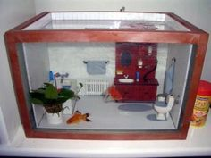 Decorate your aquarium to look like a dollhouse! Measure your aquarium, cut pieces of wood to line each edge of the tank and assemble the wood frame. Cut pieces of tile to fit in your tank like a dior