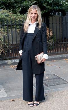 Vogue Senior Editor Meredith Melling-Burke is the epitome of how overalls can be worn in a completely chic style. These wide-legged bottoms are perfectly tailored for just the right amount of heel to be exposed as she layers this look with a crisp white Oxford shirt and a long black trench coat.