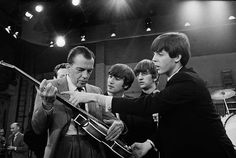 Television host Ed Sullivan receives some guitar lessons from Paul McCartney in between rehearsals at CBS television studios in Manhattan, 8 February 1964 Bettmann/Corbis