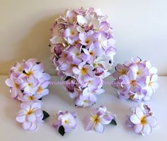 Lilac and Lavender Plumeria/Frangipani and Orchid Bridal bouquets from  PlumeriasWeddingFlowerBoutique