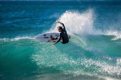 """Julian Wilson Surfing in Jeffreys Bay, South Africa. - Julian Wilson Surfing in Jeffreys Bay, South Africa. Trevor Moran / Red Bull Content Pool <a href=""""https://www.redbullphotography.com/editors-choice/1418308570242-1217116640"""">Red Bull Photography</a>"""