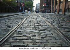 Dumbo, Brooklyn cobblestone street with train tracks.