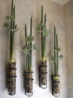 Artificial Stems with pebbles & set acrylic for a fresh spa look by Embellishments Interior Design