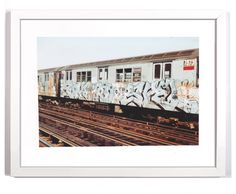 Subway Series- 10 by Cope2- This Archival Pigment Print Photo was from a series of 3 different sized prints, this is the only version of this size. Features is a photo of Cope2's graffiti work from the New York subway trains circa the 1980s. A series of train cars sit idle on the tracks covered in tags, throwups and spray paint drawings. Limited edition Archival Pigment Print art framed & Matted artwork by famous artist Cope2.