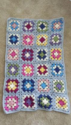 Granny square bag in progress.